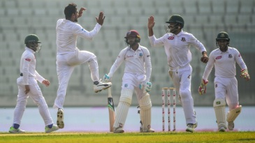 Mehidy Hasan celebrates a wicket with team-mates
