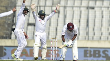 Bangladesh's players successfully appeal for an lbw against Sunil Ambris