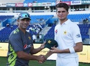 Bowling coach Azhar Mahmood presents Shaheen Shah Afridi with his Pakistan cap, Pakistan v New Zealand, 3rd Test, Abu Dhabi, 1st day, December 3, 2018
