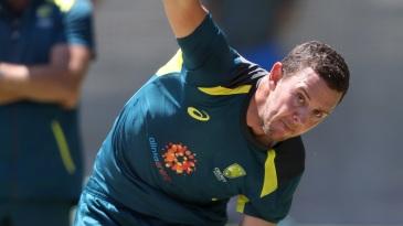 Josh Hazlewood bowls during a net session