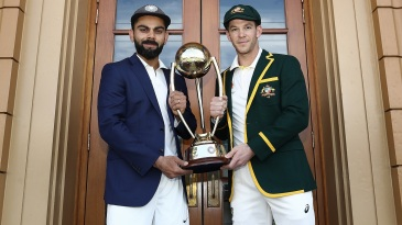 Virat Kohli and Tim Paine pose with the Border-Gavaskar Trophy ahead of the first Test