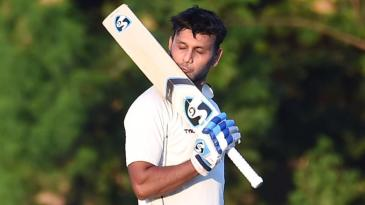 Milind Kumar kisses his bat after reaching a double century