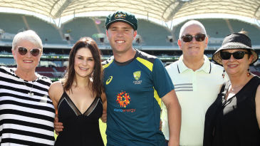 Marcus Harris poses with his proud family after receiving his Test cap