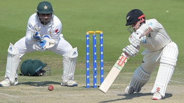 Kane Williamson forces a ball through the off side as Sarfraz Ahmed looks on
