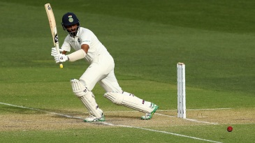 Cheteshwar Pujara flicks the ball away
