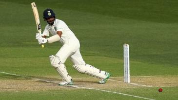 Cheteshwar Pujara flicks the ball away