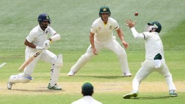 Peter Handscomb attempts a catch to dismiss Cheteshwar Pujara