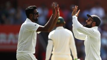 R Ashwin high fives Virat Kohli