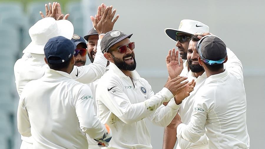 Virat Kohli celebrates with his team-mates