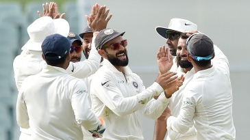 Virat Kohli celebrates with his team-mates