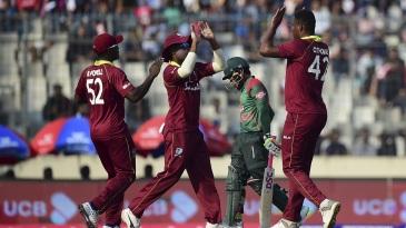 Oshane Thomas celebrates after getting Mushfiqur Rahim out