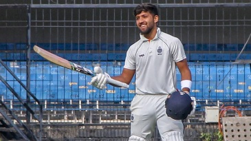 Ajay Rohera acknowledges the applause after hitting 267* on debut