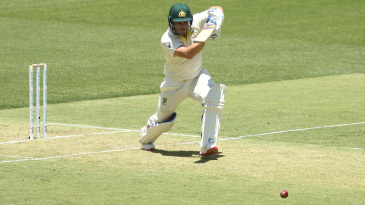 Aaron Finch drives the ball away