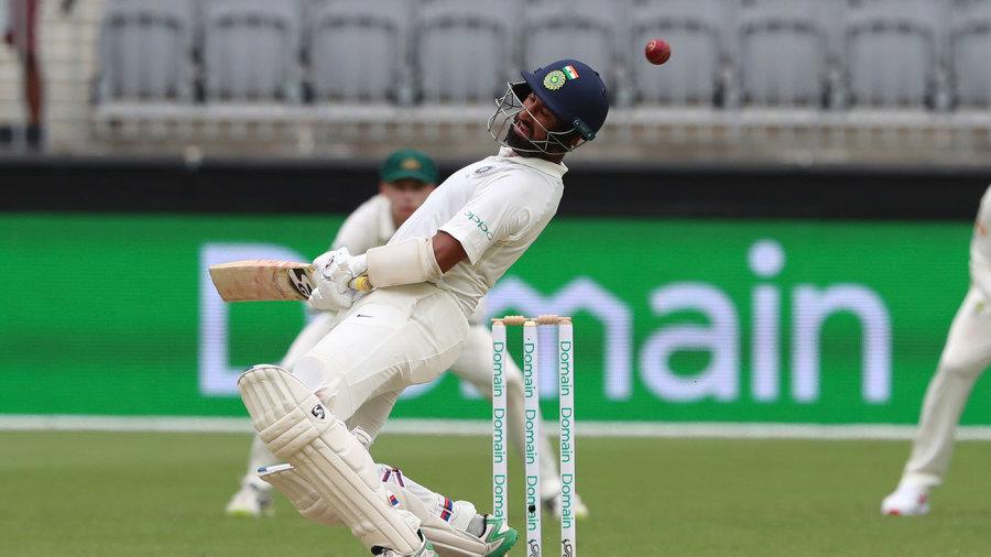 Cheteshwar Pujara sways away from a bouncer