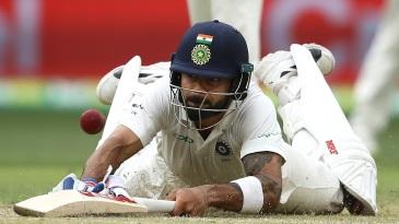 Virat Kohli dives to make his ground