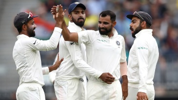 Mohammed Shami celebrates a wicket with his team-mates