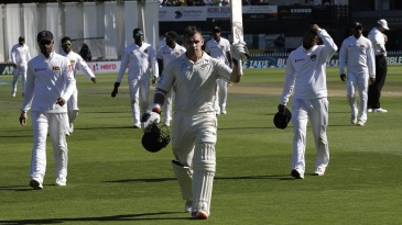 Tom Latham walks off the field, having carried his bat through for a remarkable 264 not out