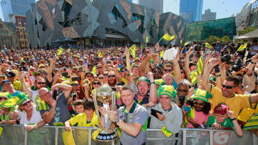 Michael Clarke shows off the World Cup trophy to fans at Federation Square in Melbourne after Australia's fifth win in the tournament