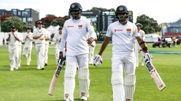 Angelo Mathews and Kusal Mendis walk off after having batted through the day