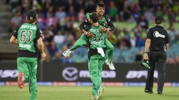 Sandeep Lamichhane leaps into the arms of Glenn Maxwell