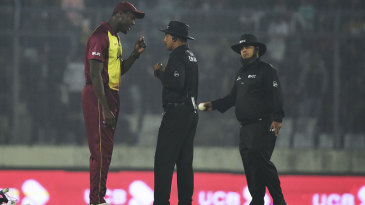 Carlos Brathwaite protests with Masudur Rahman about a controversial no-ball call by umpire Tanvir Ahmed (right)