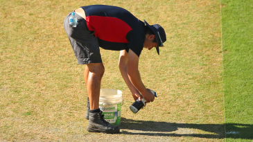 The MCG curator Matt Page works on the pitch during an Australia training session