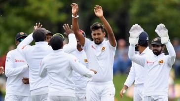 Suranga Lakmal celebrates with his team-mates