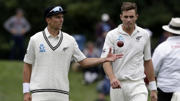 Trent Boult throws the ball to Tim Southee