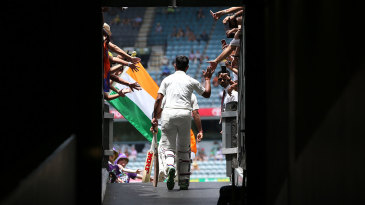 Cheteshwar Pujara walks out for the second session