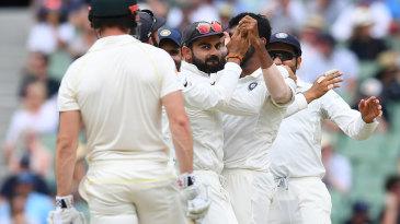 Virat Kohli looks at Shaun Marsh after he is dismissed by a Jasprit Bumrah slower ball