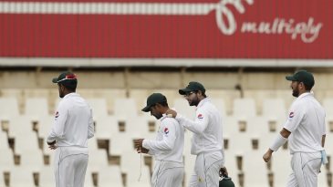The Pakistan team troop off the field after losing the first Test in three days