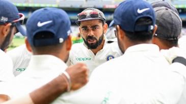 Virat Kohli leads India's team talk before the fourth innings