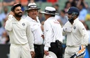 Virat Kohli, Rishabh Pant, Marais Erasmus and Ian Gould share a lighter moment, Australia v India, 3rd Test, Melbourne, 4th day, December 29, 2018