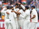 Ishant Sharma is mobbed by team-mates after taking Australia's last wicket, Australia v India, 3rd Test, Melbourne, 5th day, December 30, 2018