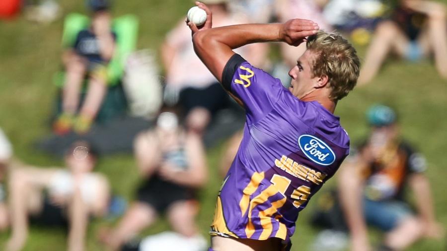 Kyle Jamieson runs in to bowl