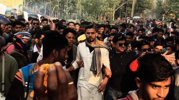Mashrafe Mortaza walks with supporters during his election campaign