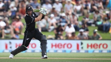 Martin Guptill drives powerfully through the off side