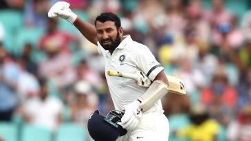 Cheteshwar Pujara celebrates his hundred