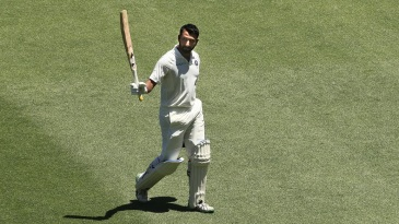 Cheteshwar Pujara leaves the field after his 193