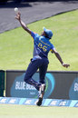 Lakshan Sandakan flicks the ball back into play before completing a catch, New Zealand v Sri Lanka, 2nd ODI, Mount Maunganui
