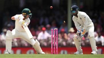 Rishabh Pant looks on as Marcus Harris plays onto his stumps