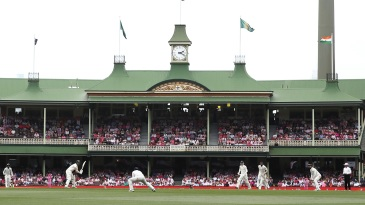 The SCG's members stand in the background as Travis Head plays a shot