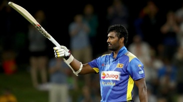 Thisara Perera raises his bat to acknowledge the applause for his first ODI century