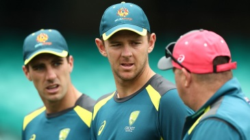 Josh Hazlewood and Pat Cummins chat with bowling coach David Saker