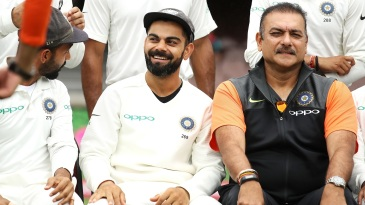 Virat Kohli and Ravi Shastri share a light moment before team photos