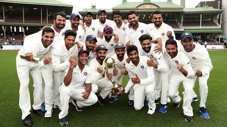 The Indian players pose with the Border-Gavaskar Trophy