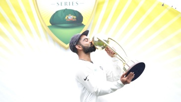 Virat Kohli kisses the Border-Gavaskar Trophy