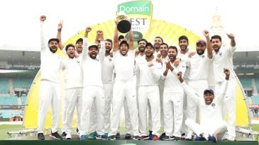 Mayank Agarwal and the India team celebrate with the Border-Gavaskar Trophy