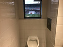 A view of play from a urinal in the members' section of the MCG, December 2018