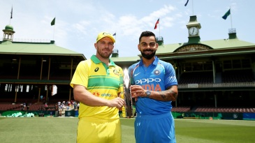 Aaron Finch and Virat Kohli pose with the ODI trophy
